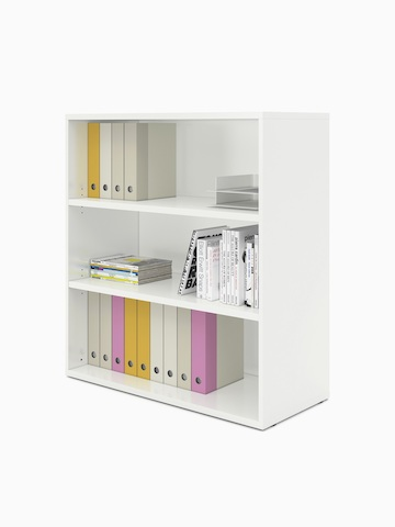 Books and binders fill an open Paragraph Storage unit with three modules and no doors, viewed at an angle.