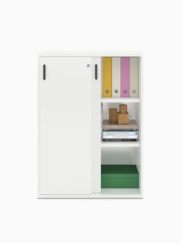 Books and binders fill a partially open Paragraph Storage unit with three modules and sliding doors, viewed from the front.