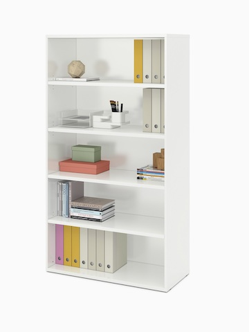 A white Paragraph Storage unit with five open modules contains books, binders, and supplies.