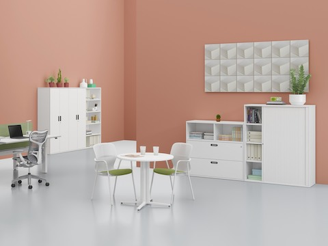 Various Paragraph Storage elements, including a cabinet, drawer unit, open modules, and lockers, support an interaction space.