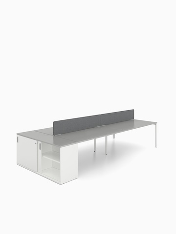 A white Paragraph Storage unit with a grey top positioned at the end of a Layout Studio benching configuration.