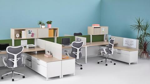 Tackable Pari Screens provide privacy for a run of Canvas Dock-Based workstations with gray Mirra 2 office chairs.