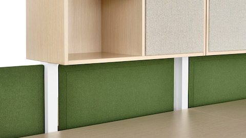 Green tackable Pari Screens fit between the overhead and surface of a Canvas Dock-Based workstation.