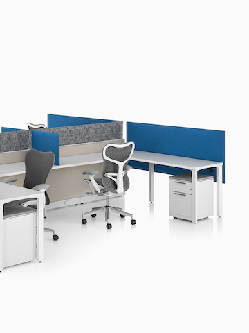 Blue Pari Screens provide seated privacy in a workstation cluster. Select to go to the Pari Screens product page.