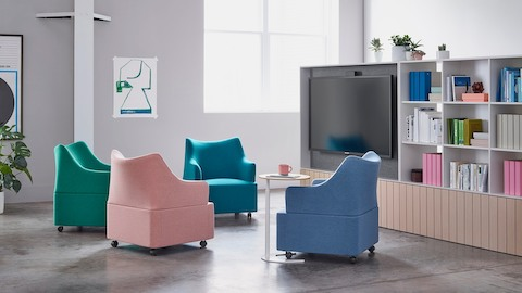 Four Plex club chairs in vibrant shades of blue, green, purple, and salmon in an informal meeting space.