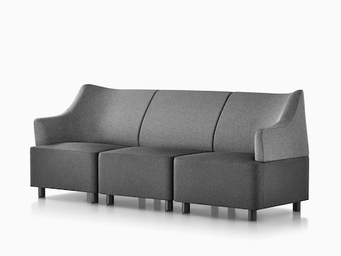 A gray Plex sofa formed from three modular elements.