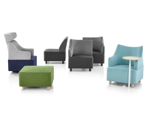 A collection of Plex seating elements, including gray modular components, blue club chairs, and a green ottoman.