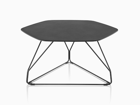 A black Polygon Wire occasional table with a hexagonal top.