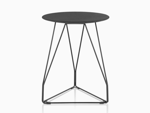 A round Polygon Wire occasional table with a black top and wire base.