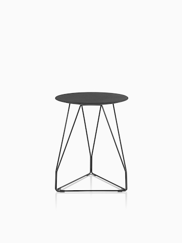 A round Polygon Wire Table with a black top.
