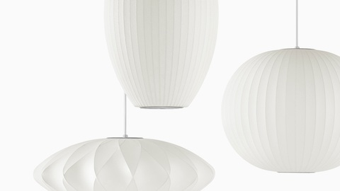 Three hanging Nelson Bubble Lamps. Select to go to the Nelson Bubble Lamps product page.