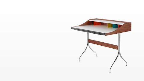 Angled view of a Nelson Swag Leg Desk with a white laminate top and colourful cubbyholes.