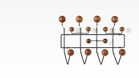 An Eames Hang-It-All with wood knobs for hanging storage.