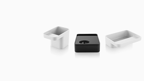 Three Formwork stackable desktop storage accessories: a white pencil cup, black box, and white tray.