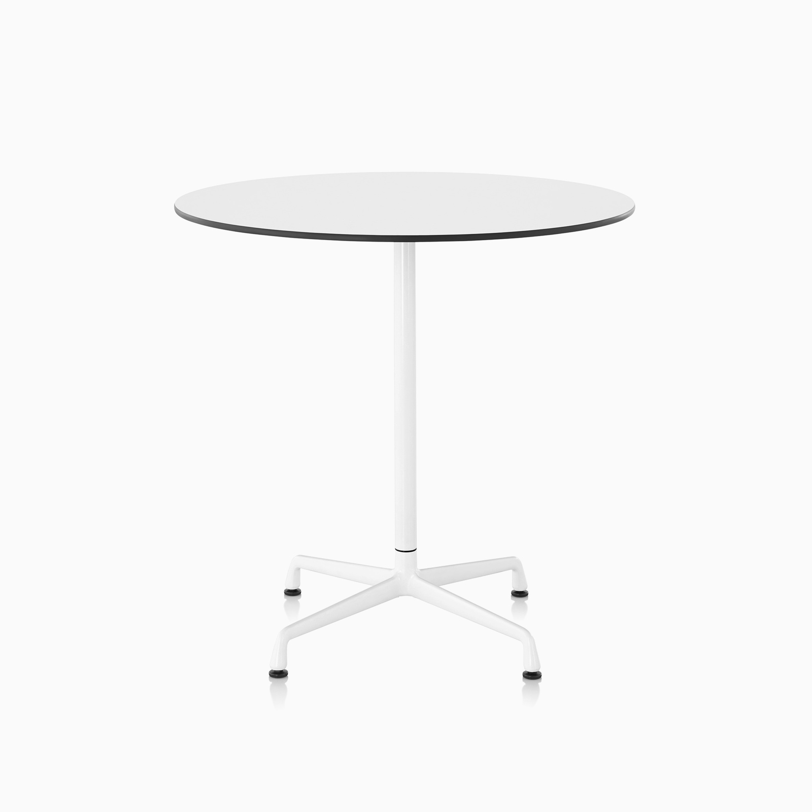 An Eames standing-height table featuring a white back-painted glass top, white column, and polished aluminum base.