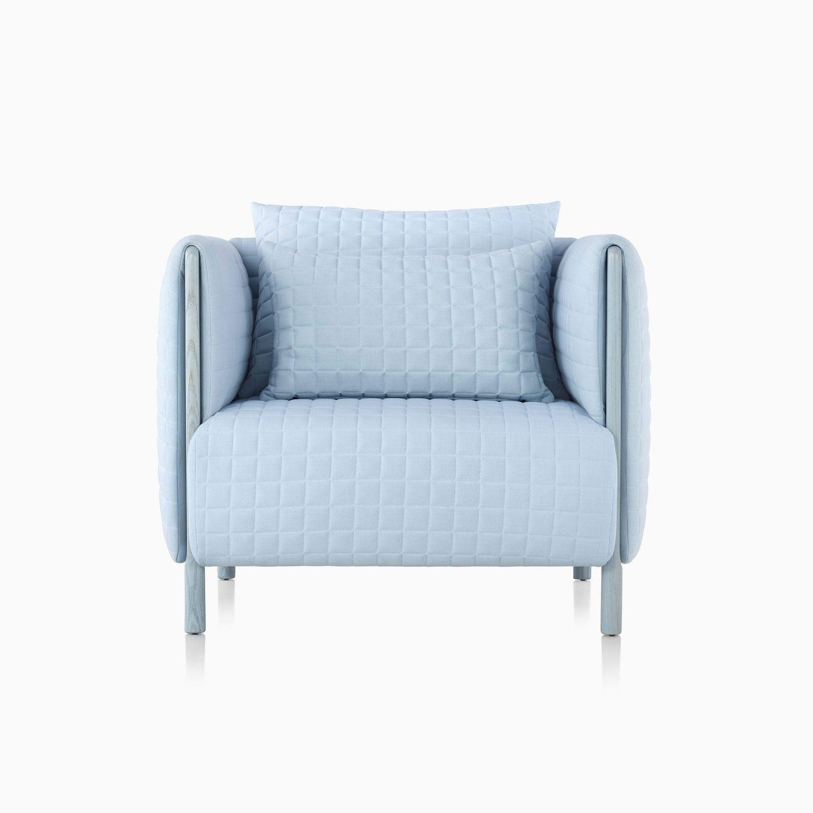 A light blue ColourForm lounge chair, viewed from the front.