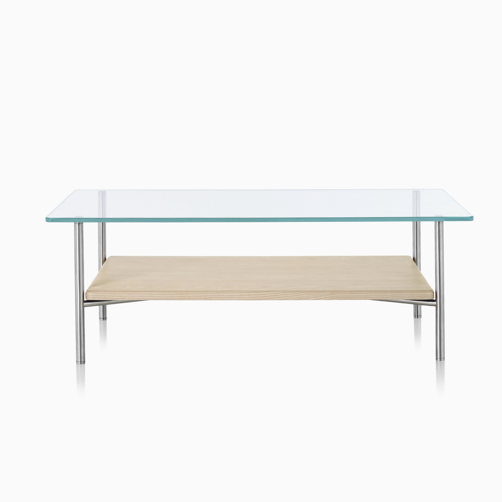 A rectangular Layer glass top occasional table with a light wood lower shelf.
