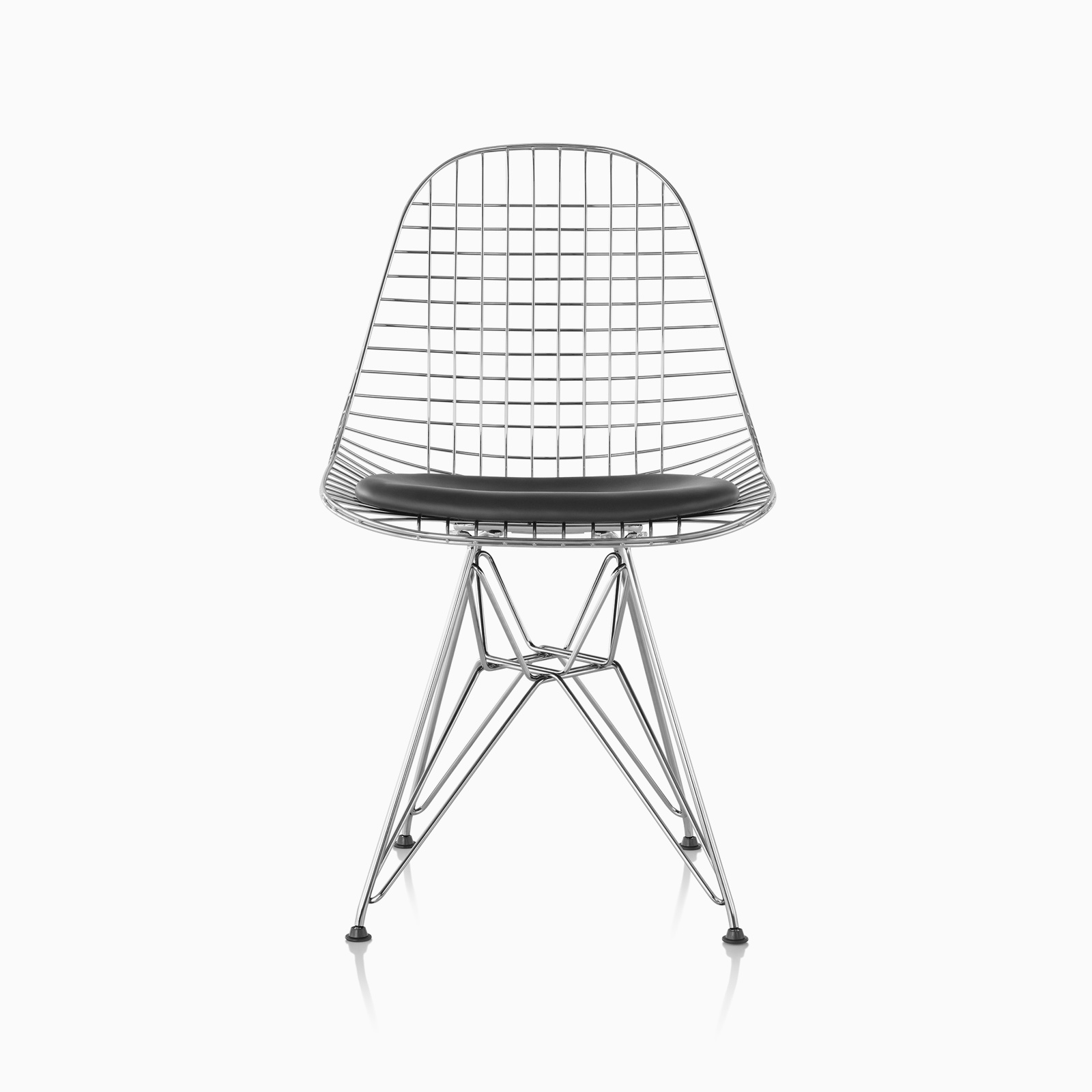 An Eames Wire Chair featuring black leather upholstered seat pads and chrome legs.