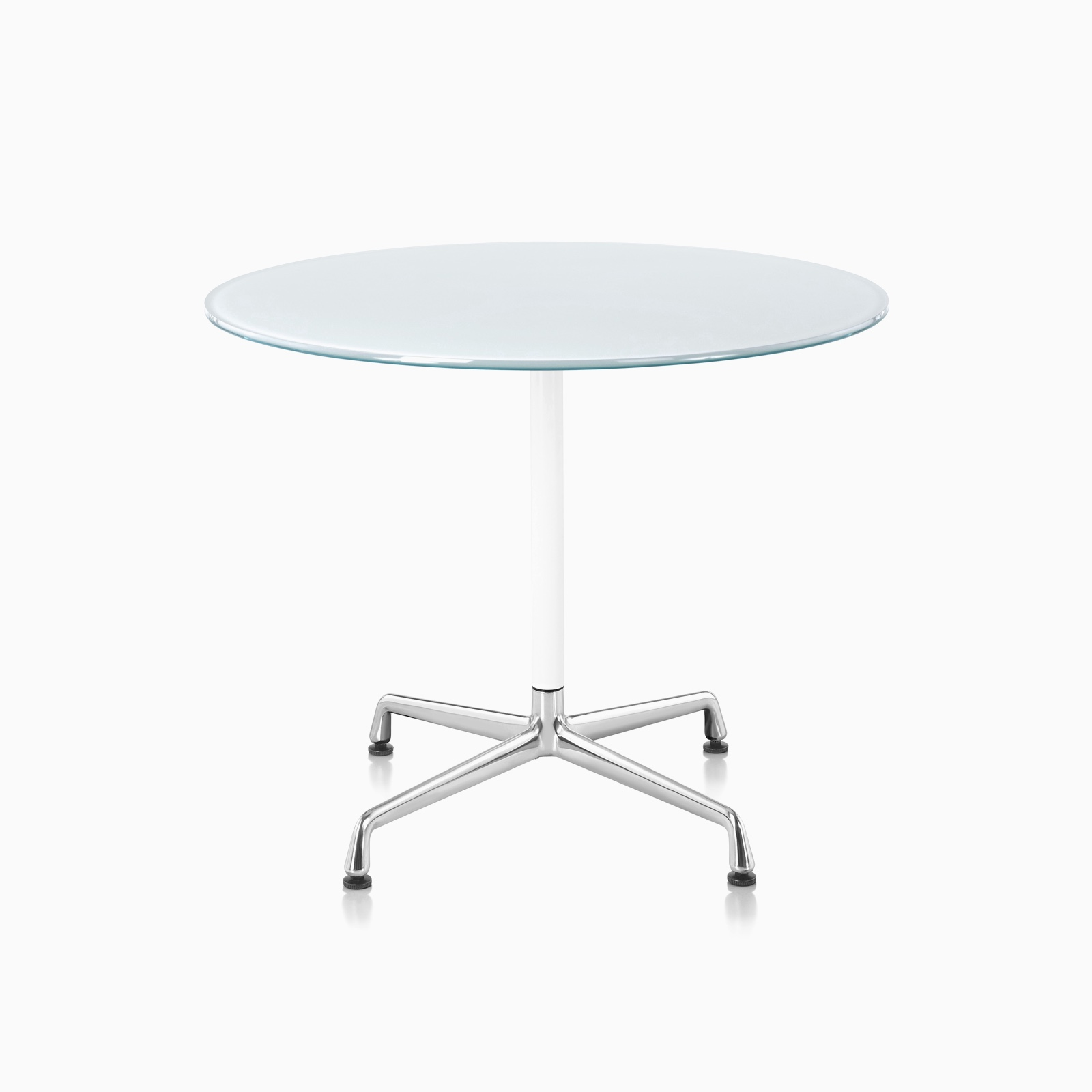 An Eames Table featuring a white back-painted glass top, white column, and polished aluminum base.