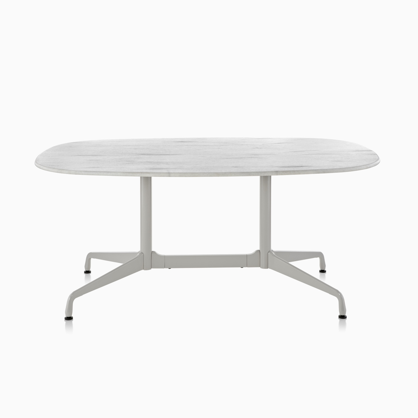 An Eames standing-height table featuring a stone top.