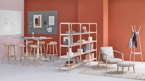 This Workshop setting features Crosshatch Stools and a standing-height Eames Table separated from a lounge area by a three-by-four unit Steelwood Shelving System bookshelf.