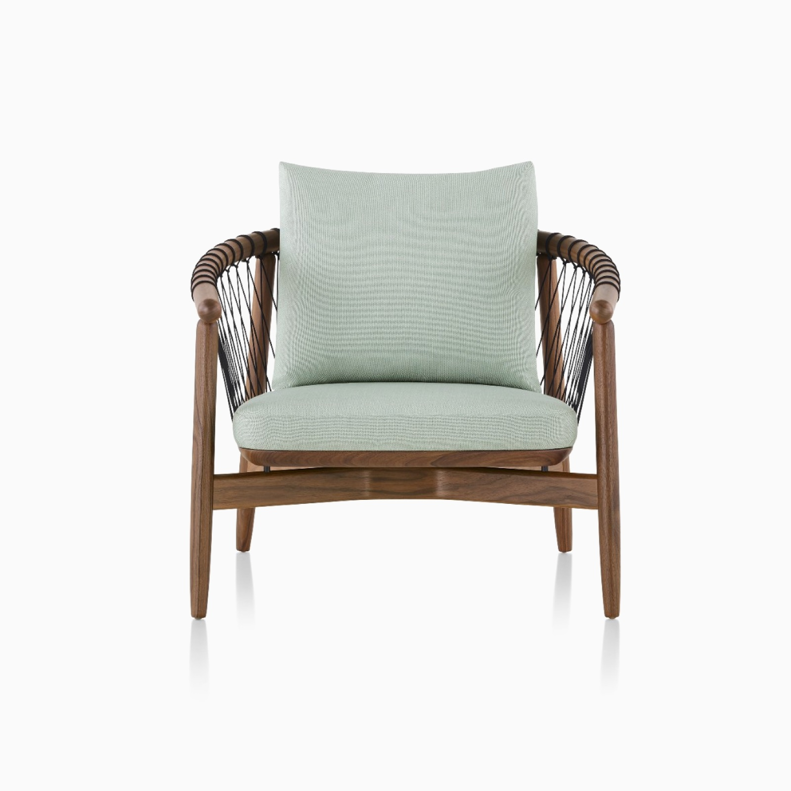 A Crosshatch Chair in Saille Celadon and Natural Walnut.