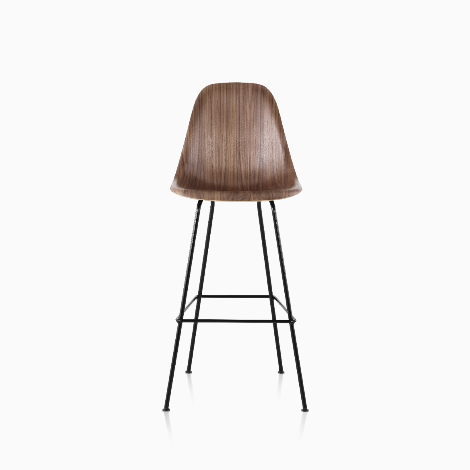 A walnut bar-height Eames Molded Wood Stool.