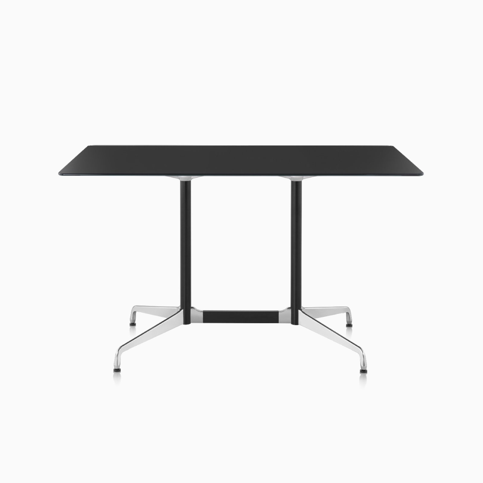 An Eames Standing Height Conference Table featuring a black back-painted glass top.