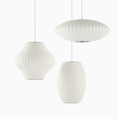 Three white Pendant Nelson Bubble Pendant lights. Select to go to the all products page for the Herman Miller Collection.