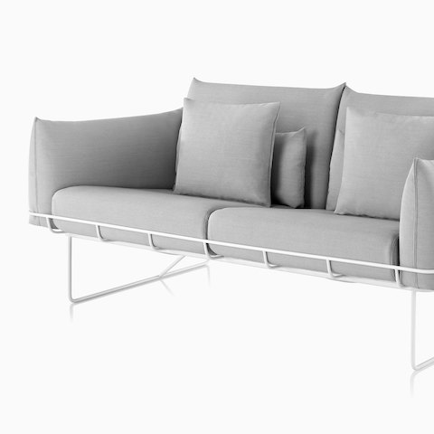 Gray Wireframe Sofa with white frame, viewed from an angle. Select to go to the all products page for the Herman Miller Collection.