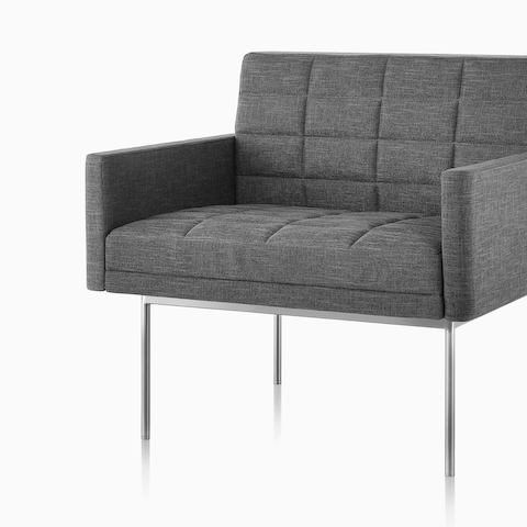 A gray Tuxedo Sofa with a bronze base, viewed from an angle. Select to go to the all products page for the Herman Miller Collection.