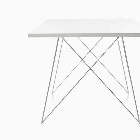 A round Magis Tavolo XZ3 Table with a black top and steel rod base, viewed from an angle. Select to go to the all products page for the Herman Miller Collection.