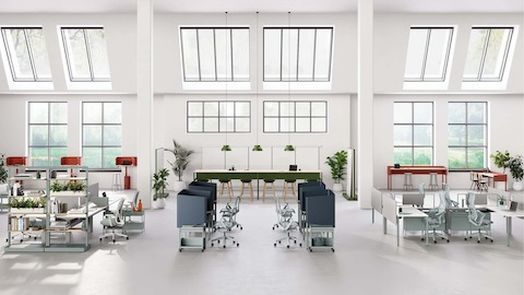 Open floor workspace with various OE1 Workspace Collection products in red, green and blue.