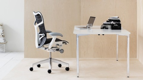 A modern home office featuring a Mirra 2 office chair and an Everywhere Table.