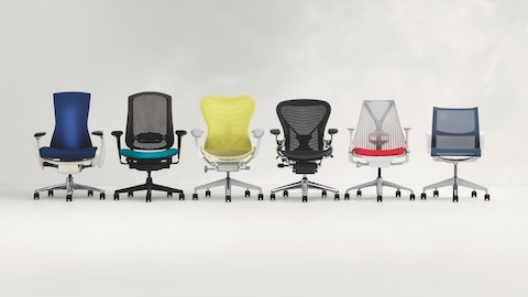 Six models of Herman Miller office chairs positioned in a row. Select to see a chart comparing Herman Miller chairs.