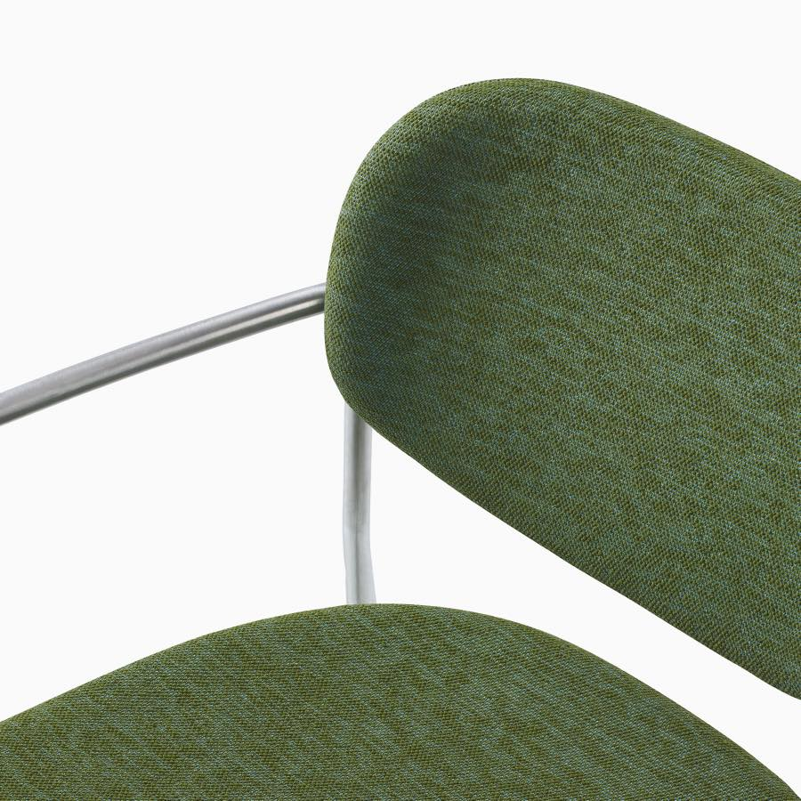 Detail image of Portrait Chair with upholstered seat and back, satin chrome frame with arms.