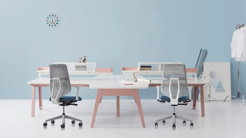 Two POSH Activity Chairs with a cluster of four Optimis bench tables in a work environment.