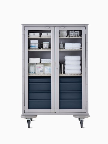 Mobile double-wide supply cart with light gray body, dark blue drawers, wire shelves, and locking glass doors.