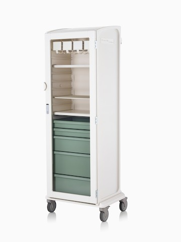Soft white locker on wheel base with keyless lock, catheter racks, shelves, and green drawers, viewed at an angle.