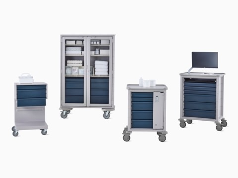 Group of Procedure and Supply Carts including L Cart, double-wide cart, supply cart, and technology cart in light gray body with dark gray drawers.