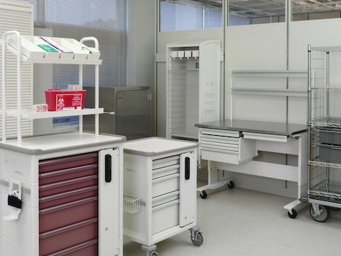 A healthcare utility room containing multiple Procedure/Supply Carts with interchangeable drawers and accessories.