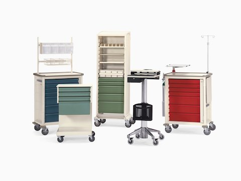 A collection of Herman Miller healthcare carts, including four Procedure/Supply Carts and one Mobile Technology Cart.