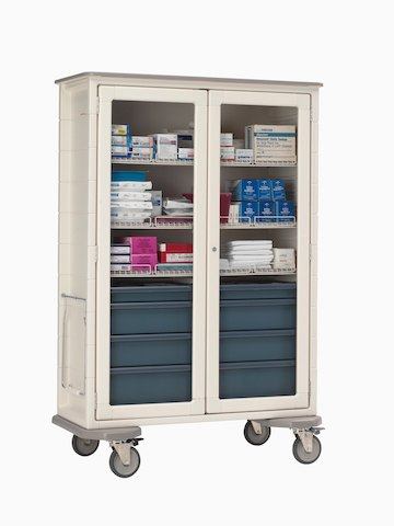A vertical Procedure/Supply cart with clear doors for quick retrieval of medical supplies.
