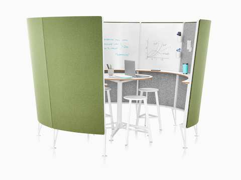 A view inside a Prospect Creative Space with green acoustic fabric on the outside and sketches on the whiteboards inside.