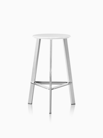 A Prospect Stool with polished legs and a white seat.