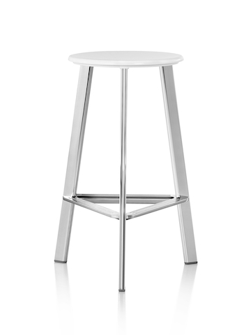 A Prospect Stool with a white seat and polished legs.
