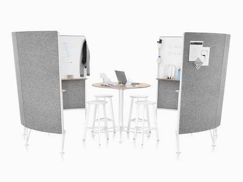 Four stools around a Prospect Table with a wood top in the middle of two Prospect 4-panel collaborative spaces with grey acoustic fabric on the outside.