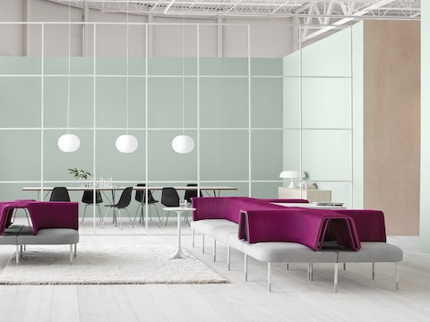 A Public Office Landscape setting featuring configurations of magenta and gray social chairs to support interaction.