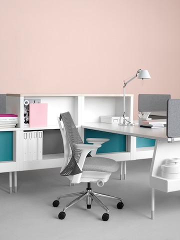 An open workstation featuring white surface and storage components from the Public Office Landscape system.