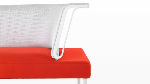 Close view of the orange seat and white back on a social chair, the core component of the Public Office Landscape system.